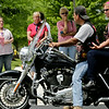 Rob Winner – rwinner@shawmedia.com<br /> <br /> Onlookers watch as cyclists begin to leave the Parkview Christian Church parking lot in Orland Park while escorting the body of U.S. Army Pfc. Aaron Toppen to St. John's Cemetery in Mokena Tuesday afternoon. The 19-year-old Mokena native was among the five American soldiers killed June 9 in a friendly-fire incident in Afghanistan.