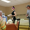 Rob Winner – rwinner@shawmedia.com<br /> <br /> Ed Wysocki (right) of Pub Grub at American Legion Post 1080 in Joliet checks on his dining area as his daughter Jackie Wysocki (center) carries away plates from a table on Wednesday, June 18, 2014.