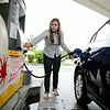 Rob Winner – rwinner@shawmedia.com<br /> <br /> Anna Mendez of Oak Lawn fills up her vehicle at the Shell gas station located near the intersection of New Lenox Road and Briggs Street in Joliet Wednesday, June 18, 2014.