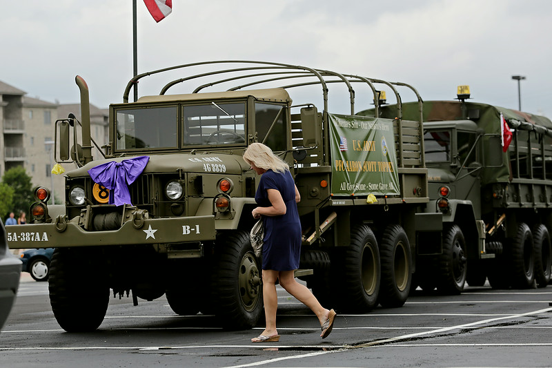 Rob Winner – rwinner@shawmedia.com<br /> <br /> A woman heads toward the entrance of Parkview Christian Church in Orland Park for the the wake of U.S. Army Pfc. Aaron Toppen on Monday, June 23, 2014.