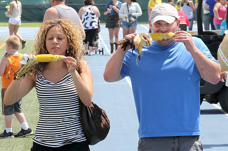 John Patsch-For Shaw Media<br /> Monica Briseno and George Sabin enjoy roasted corn as they walk through Taste of Joliet.
