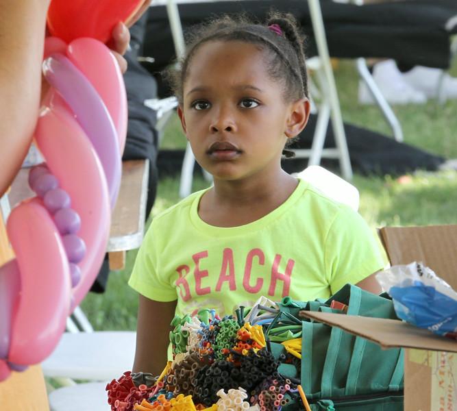 John Patsch-For Shaw Media<br /> Former Joliet resident Kaylen Burrell, 5, watches as balloon artist Tracy Smith makes her a sculpture.