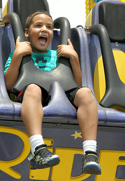 John Patsch-For Shaw Media<br /> Phoenix Taylor, 9, from Plainfield enjoys the Freefall ride at Taste of Joliet.