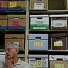 Rob Winner – rwinner@shawmedia.com<br /> <br /> Boxes of archived documents that have been scanned are seen behind Will County Board member Tom Weigel of District 12 during a tour of of the Nicholson Street Facility in Joliet Tuesday, July 8, 2014.