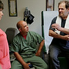 Rob Winner – rwinner@shawmedia.com<br /> <br /> Nurse Cathy Langenderfer (From left to right) and Dr. Omar Garcia listen to Daybreak resident Robert Davis during a visit to the Daybreak on-site clinic in Joliet Monday, June 9, 2014.