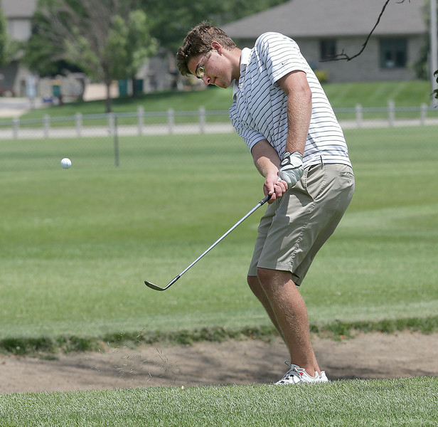 John Patsch for Shaw Media<br /> <br /> Huston Dass chips to the 12th green at the Junior JPD tournament.