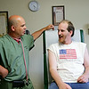 Rob Winner – rwinner@shawmedia.com<br /> <br /> Dr. Omar Garcia (left) talks with resident Matthew Condit during a visit at the Daybreak on-site clinic in Joliet Monday, June 9, 2014.