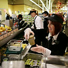 Rob Winner – rwinner@shawmedia.com<br /> <br /> Department lead Sara Geiss finishes making a smoothie for a customer at Mariano's in Shorewood during the store's grand opening Tuesday, July 15, 2014.