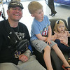 John Patsch-For Shaw Media<br /> Wounded veteran Capt. Anthony Simone waits to visit the Wounded Warrior Mustang at Terapelli Ford with his children, Will, 4, and Avery,1.