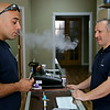 Rob Winner – rwinner@shawmedia.com<br /> <br /> Ammar Ziadah (left) of Oak Forest samples a strawberry lemonade e-liquid that contains nicotine with his e-cigarette at Ramy Betouni's Vapor Cabin in Lockport Monday, July 14, 2014. Ziadah quit smoking cigarettes as part of a New Year's resolution.