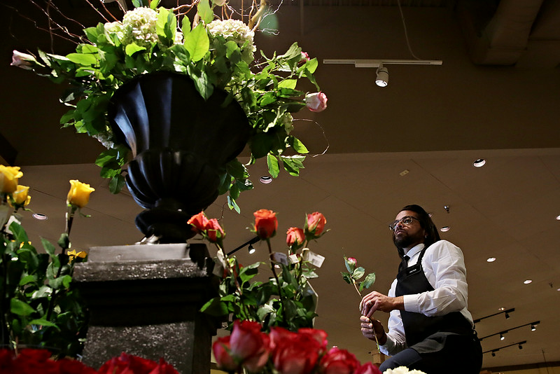 Rob Winner – rwinner@shawmedia.com<br /> <br /> Floral designer Hector Crespo works on a display near the north entrance of Mariano's during the store's grand opening in Shorewood Tuesday, July 15, 2014.