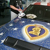 John Patsch-For Shaw Media<br /> John Patsch-For Shaw Media<br /> Capt. Anthony Simone looks at all of the signitures on the Wounded Warrior Mustang at Terapelli Ford.