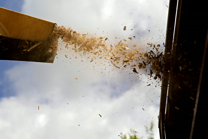 Rob Winner – rwinner@shawmedia.com<br /> <br /> A wood chipper sprays debris from an ash tree into the back of a truck on Partridge Drive in Plainfield Wednesday, July 16, 2014.