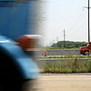 Rob Winner – rwinner@shawmedia.com<br /> <br /> A blue semitrailer is seen from traveling south on West Frontage Road as an orange semitrailer is seen traveling north on Interstate 55 in Channahon Tuesday, July 22, 2014.