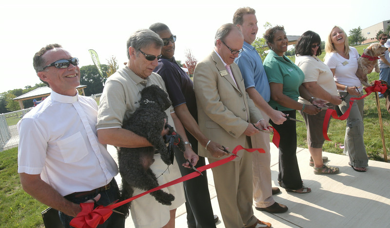 John Patsch-For Shaw Media<br /> Officials from Will County, Joliet Chanahon, and the Forrest Preserve District of Will County cut the ribon openint the new dog park at the Rock Run Access on McClintock Road.