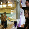 Rob Winner – rwinner@shawmedia.com<br /> <br /> Bridgette and Adam Sojka watch the pool as their two boys, Nicholas and Matthew, take swim lessons at the Galowich Family YMCA in Joliet Thursday, July 17, 2014.