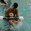 Rob Winner – rwinner@shawmedia.com<br /> <br /> Lifeguard and instructor John Pierson helps Calista Nebel, 3, learn how to kick with her feet while floating on her back during a swimming lesson at the Galowich Family YMCA in Joliet Thursday, July 17, 2014.