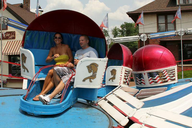 Christine Muilenburg - For Shaw Media                                           Lisa and Bill Reynolds of Plainfield enjoy a ride on the Tilt-A-Whirl on Saturday, July 19, 2014 during Plainfield Fest.  Plainfield Fest continues Sunday, July 20, 2014.
