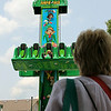 Christine Muilenburg - For Shaw Media        Sienna Menietta, 4, rides the Jumpin' Jack under the watchful eye of her grandmother, Cindy Feeney on Saturday, July 19, 2014 during Plainfield Fest.  Plainfield Fest continues Sunday, July 20, 2014.