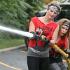 John Patsch-For Shaw Media<br /> Jacki O'Hara and Lynnette HHinke take aim at a target during the BBBS Amazing Race.