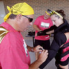 John Patsch-For Shaw Media<br /> Dave and Jum Tebo dress Stephanie Tebo in riot gear at the Joliet Police Station during the BBBS Amazing Race.