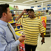 "Rob Winner – rwinner@shawmedia.com<br /> <br /> Store manager Jason Watanabe (left) meets with local resident Michael Pinnick at the Walgreens located at 358 East Cass Street in Joliet Wednesday, Aug. 13, 2014. Pinnick is putting together a back to school fair and is collecting supplies that will benefit local children. Watanabe who is helping donate supplies to Pinnick through Walgreens said, ""I really like his story and where he came from. That's why I'm doing it for Michael."""