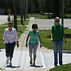 Rob Winner – rwinner@shawmedia.com<br /> <br /> (From left to right) Workers at the Grundy County Administration building, including Jean Koerner, Paula Goodwin and Stacy McCarthy take a walk along Union Street in Morris for exercise Friday, Aug. 15, 2014.