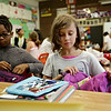 Rob Winner – rwinner@shawmedia.com<br /> <br /> Fifth graders Micah Greene (left) and Mea Majewski sort their supplies during the first day of school at Eisenhower Academy in Joliet Monday, Aug. 18, 2014.