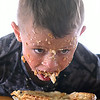 John Patsch-For Shaw Media<br /> Kieran Heak, 9, won the Guess What's Cooking pie eating contest for ages 6-10 at Crosswoods Fest in Shorewood.