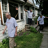 Rob Winner – rwinner@shawmedia.com<br /> <br /> (From left to right) Brothers Don, Ray and Lawrence Sabec leave their New Lenox home for a temporary rental unit on Friday, August 1, 2014. The house will be renovated by volunteer contractors, electricians and plumbers for the next several weeks.