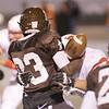 John Patsch-For Shaw MediaJCA quarterback Michael Johnson hangs onto the ball as Benet's Trenton Kramer tackles him.