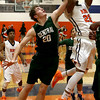 John Patsch-For Shaw Media<br /> Plainfield Central's Scott Gustafson trys to block Romeoville's Tony Borges' shot.