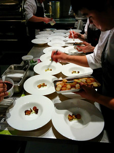 Chefs preparing kohlrabi with other brassicas, rye, and meyer lemon