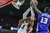 PHILADELPHIA - NOVEMBER 17: Temple Owls forward/center Devontae Watson (23) is fouled across with an arm rake across his face during the NCAA basketball game November 17, 2014 in Philadelphia.