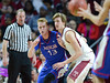PHILADELPHIA - NOVEMBER 14:  Temple Owls forward Jimmy McDonnell (41) defends against American University Eagles forward Kevin Panzer (13) in the post during the season opening game against American November 14, 2014 in Philadelphia.