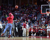 PHILADELPHIA - FEBRUARY 14: A Temple fan takes a shot from half court in an on-court contest during the AAC conference college basketball game January 14, 2015 in Philadelphia.