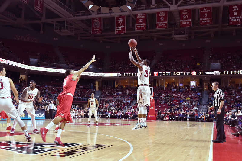 PHILADELPHIA - FEBRUARY 26: Temple Owls guard Devin Coleman (34) takes a three point shot during the AAC conference college basketball game  February 26, 2015 in Philadelphia.