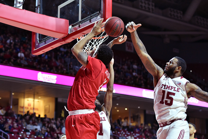 PHILADELPHIA - FEBRUARY 26: Temple Owls forward Jaylen Bond (15) blocks a shot by a Houston player during the AAC conference college basketball game  February 26, 2015 in Philadelphia.