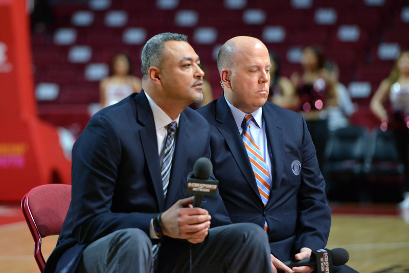 PHILADELPHIA - FEBRUARY 26:  CBS broadcasters  Alaa Abdelnaby  (fore) and Tom McCarthy prepare to provide a pre game report prior to the AAC conference college basketball game  February 26, 2015 in Philadelphia.
