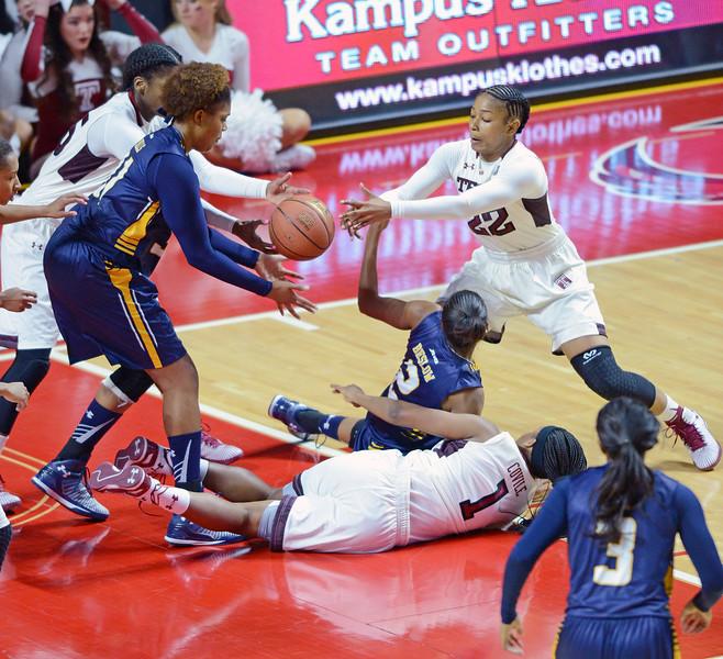 PHILADELPHIA - NOVEMBER 14:  Temple Owls guard Tanaya Atkinson (22) tries to grab a loose ball during the season opening ladies basketball game against LaSalle November 14, 2014 in Philadelphia.