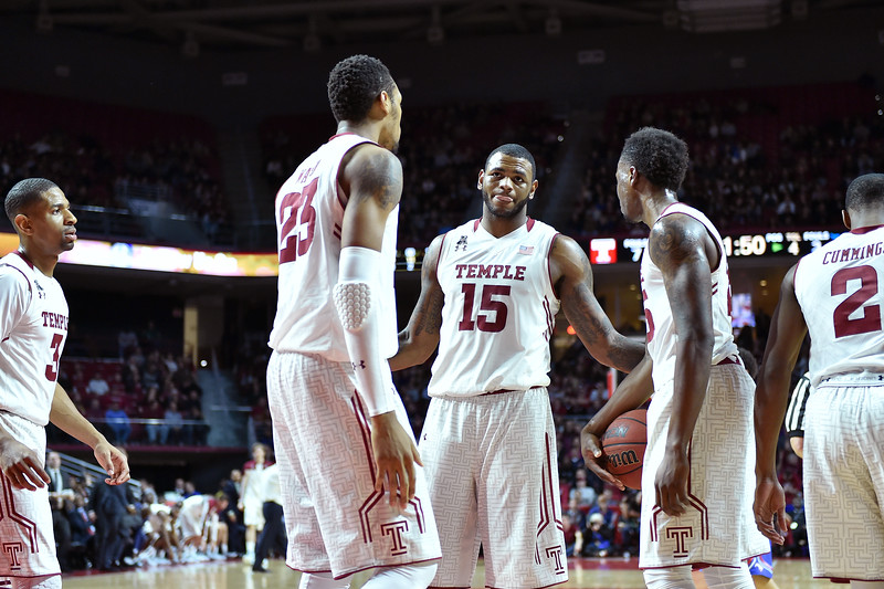 PHILADELPHIA - JANUARY 14: Temple Owls forward Jaylen Bond (15) gathers his teammates following a foul call during the AAC conference college basketball game January 14, 2015 in Philadelphia.