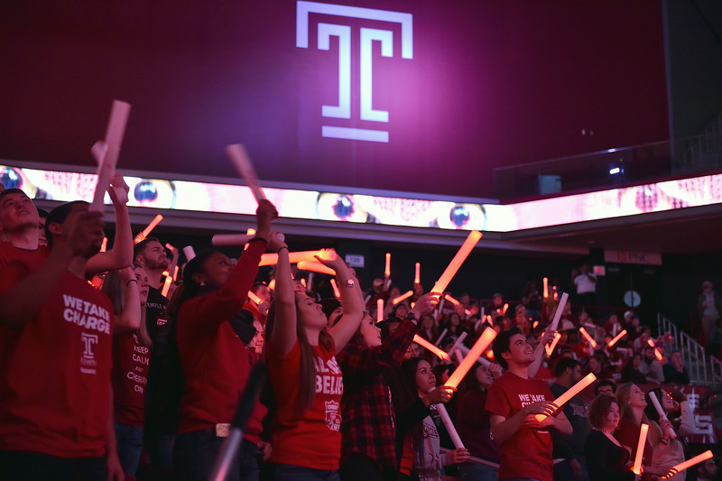 PHILADELPHIA - JANUARY 14: The Temple student section waves glow sticks prior to the AAC conference college basketball game January 14, 2015 in Philadelphia.