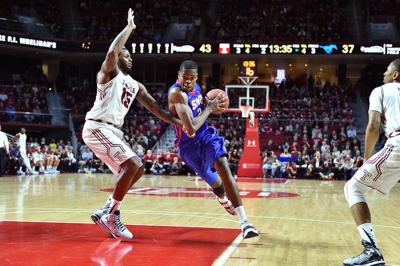 PHILADELPHIA - JANUARY 14: Southern Methodist Mustangs center Yanick Moreira (2) drives to the basket as Temple Owls forward Jaylen Bond (15) defends during the AAC conference college basketball game January 14, 2015 in Philadelphia.