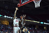 PHILADELPHIA - JANUARY 4: Temple Owls forward Jaylen Bond (15) puts up a shot over UCF Knights forward Staphon Blair (52) during the American Athletic Conference basketball game January 4, 2015 in Philadelphia.