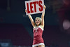 PHILADELPHIA - JANUARY 4: A Temple cheerleader holds up a Let's sign during the American Athletic Conference basketball game January 4, 2015 in Philadelphia.