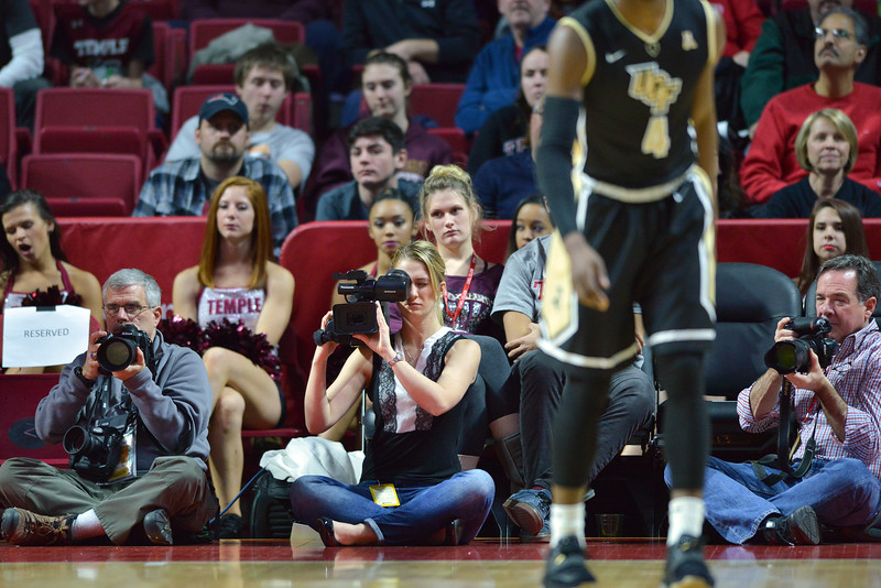 PHILADELPHIA - JANUARY 4: Photographers and videographers cover the American Athletic Conference basketball game January 4, 2015 in Philadelphia.