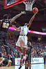 PHILADELPHIA - JANUARY 4: Temple Owls guard Josh Brown (1) shoots as he hangs in the air during the American Athletic Conference basketball game January 4, 2015 in Philadelphia.