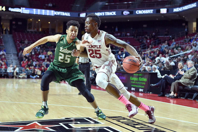 PHILADELPHIA - JANUARY 22: Temple Owls guard Quenton DeCosey (25, w/ball) drives past South Florida Bulls guard Troy Holston Jr. (25) during the AAC conference college basketball game January 22, 2015 in Philadelphia.