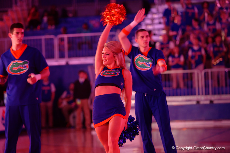 A Florida Gator cheerleader cheers on during player introductions.  Florida Gators Womens Basketball vs Georgia Bulldogs.  February 28th, 2015. Gator Country photo by David Bowie.