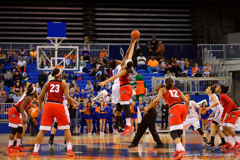 Florida Gators forward Kayla Lewis leaps up and wins the opening tip off.  Florida Gators Womens Basketball vs Georgia Bulldogs.  February 28th, 2015. Gator Country photo by David Bowie.